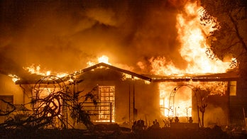 PG&E charged in California wildfire that killed four and destroyed hundreds of homes