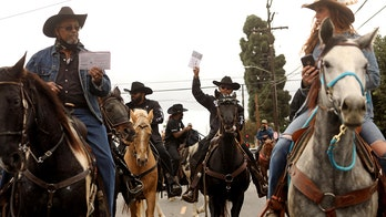 'Compton Cowboys' deliver ballots on horseback