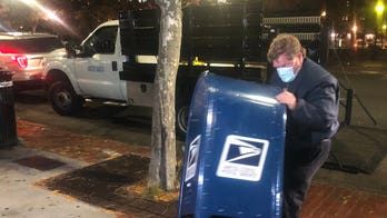 Boston Police launch investigation of burnt mail inside USPS box