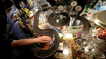 Prague cafe employees set up slot car races throughout bar emptied by COVID-19