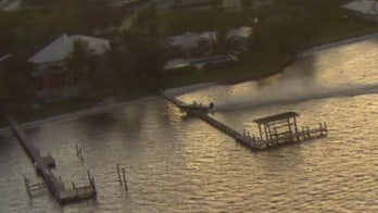 Runaway boat in Florida goes airborne, crashes into dock after 'photo shoot' goes awry