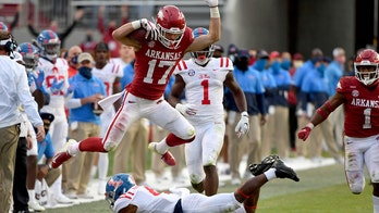 Arkansas forces seven turnovers, beats Ole Miss 33-21