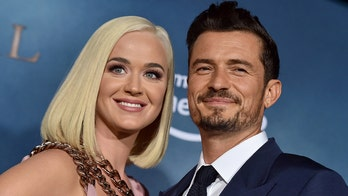 Katy Perry, Orlando Bloom create song encouraging fans to vote in person