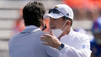Kansas coach cleared of virus but skips West Virginia game