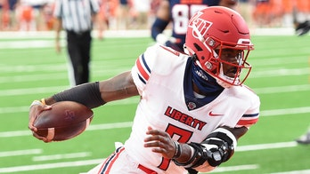 Liberty stays unbeaten and defeats struggling Syracuse 38-21