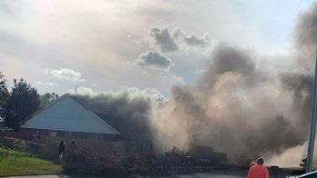 Navy plane crashes into Alabama neighborhood, killing both crewmen