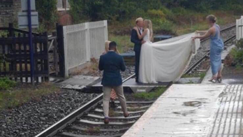 Railway operator blasts bride, groom seen taking wedding pics on railroad tracks: 'Plain stupidity'