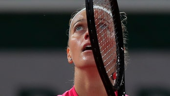 Emotions flood back for Kvitova as she reaches quarterfinals