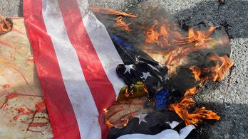 Opposing Boston protest groups go head-to-head, with some burning flags