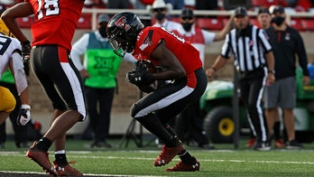 McPhearson fumble return lifts Texas Tech over West Virginia