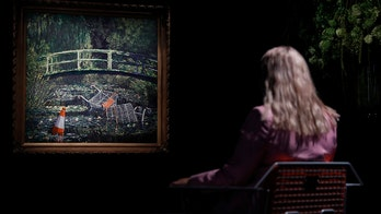 Banksy artwork sells for nearly $10M at auction