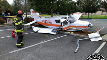 Small plane crash-lands in Washington state parking lot after losing power