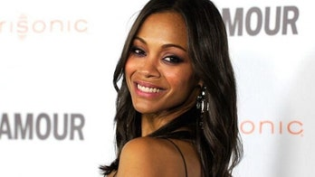 Zoe Saldana poses in pink underwear in honor of Breast Cancer Awareness Month