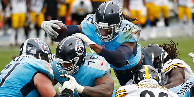 Tennessee Titans running back Derrick Henry (22) follows the blocking of offensive guard Rodger Saffold (76) as Henry scores a touchdown against the Pittsburgh Steelers in the second half of an NFL football game Sunday, Ott. 25, 2020, a Nashville, Tenn. (AP Photo/Wade Payne)