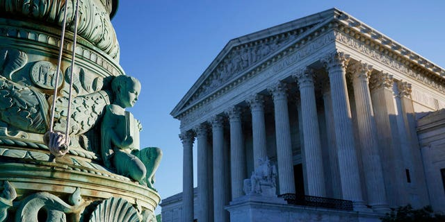 The Supreme Court is seen in Washington, Monday, Oct. 5, 2020, as the justices begin a new term following the recent death of their colleague, Ruth Bader Ginsburg.