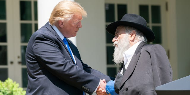 President Donald J. Trump listens to Rabbi Yisroel Goldstein of the Chabad of Poway, California, at the National Day of Prayer Service in the Rose Garden, May 2, 2019. (Official White House photo by Tia Dufour)