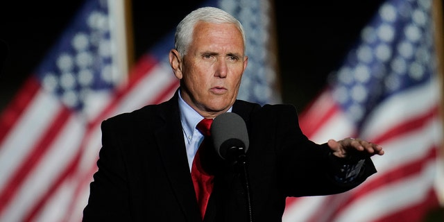 Vice President Mike Pence speaks at a campaign event, Wednesday, Oct. 28, 2020, in Flint, Mich. (AP Photo/Paul Sancya)