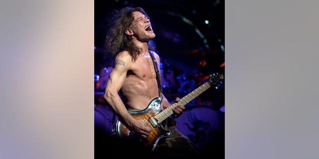 FILE - In this Aug. 5, 2004 file photo, Van Halen guitarist Eddie Van Halen performs in Phoenix. (AP Photo/Tom Hood, File)