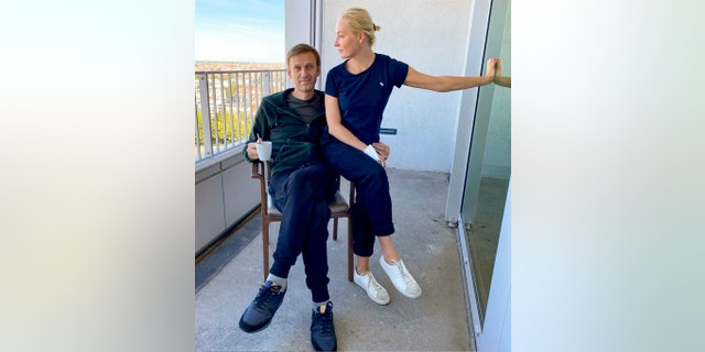 "In this photo published by Russian opposition leader Alexei Navalny on his Instagram account on  Sept. 21, Russian opposition leader Alexei Navalny and his wife Yulia pose for a photo in a hospital in Berlin. The German hospital treating Russian opposition leader Alexei Navalny for poisoning says his condition improved enough for him to be released from the facility. The Charite hospital in Berlin said Wednesday Sept. 23, 2020 that after 32 days in care, Navalny's condition ""improved sufficiently for him to be discharged from acute inpatient care."" (Navalny Instagram via AP)"