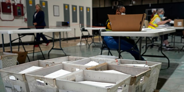 In this Sept. 3, 2020, file photo, workers prepare absentee ballots for mailing at the Wake County Board of Elections in Raleigh, N.C. (AP Photo/Gerry Broome)