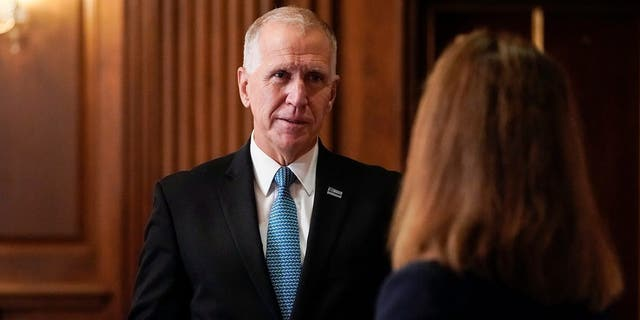 Sen. Thom Tillis, R-N.C., meets with Judge Amy Coney Barrett, President Donald Trump's nominee to the Supreme Court, on Capitol Hill in Washington, Wednesday, Sept, 30, 2020. (Joshua Roberts/Pool via AP)
