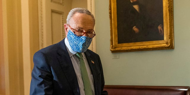 Senate Minority Leader Chuck Schumer walks outside the Senate floor on Capitol Hill, Thursday, Oct. 1, 2020, in Washington. Schumer Tuesday again forced senators to vote on shutting down the Senate until after the election. (AP Photo/Manuel Balce Ceneta)