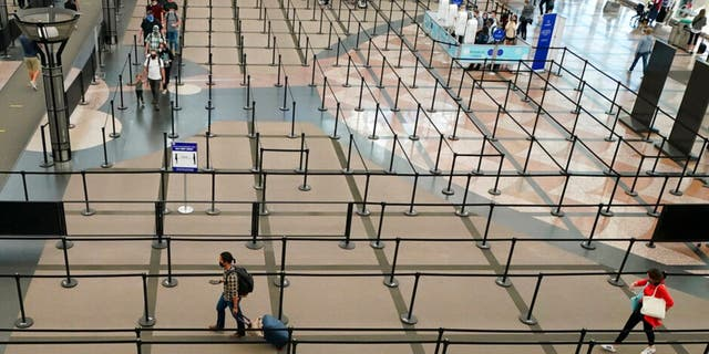 The number of travelers passing through TSA checkpoints dropped to fewer than 100,000 on several days earlier this year. (AP Photo/David Zalubowski)