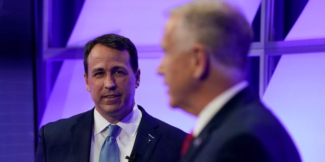 Democratic challenger Cal Cunningham, left, and U.S. Sen. Thom Tillis, R-N.C. talk during a televised debate Thursday, Oct. 1, 2020 in Raleigh, N.C. (AP Photo/Gerry Broome, Pool)
