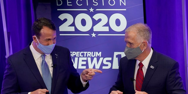 Democratic challenger Cal Cunningham, left, and U.S. Sen. Thom Tillis, R-N.C. greet each other after a televised debate Thursday, Oct. 1, 2020, in Raleigh, N.C. (AP Photo/Gerry Broome, Pool)