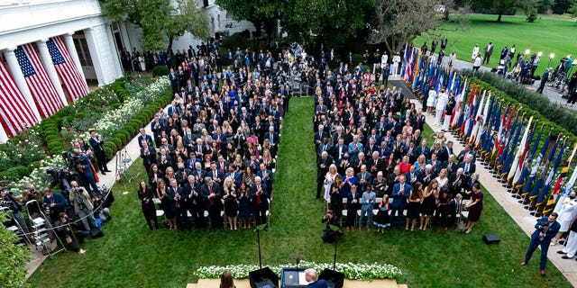 In this Sept. 26, 2020, photo President Donald Trump, center, stands with Judge Amy Coney Barrett as they arrive for a news conference to announce Barrett as his nominee to the Supreme Court, in the Rose Garden at the White House in Washington. Former New Jersey Gov.
