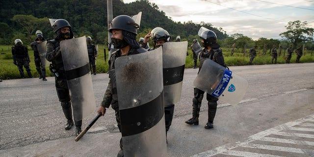 Security forces block Honduran migrants in San Luis Peten, Guatemala, Saturday, Oct. 3, 2020. (Associated Press)