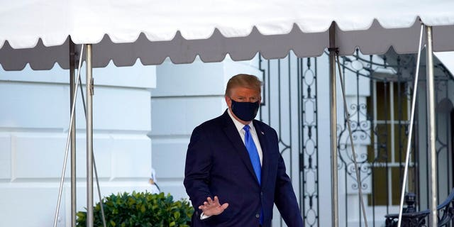 President Donald Trump waves to members of the media as he leaves the White House to go to Walter Reed National Military Medical Center after he tested positive for COVID-19 in Washington. October 2, 2020. (AP Photo/Alex Brandon, File)