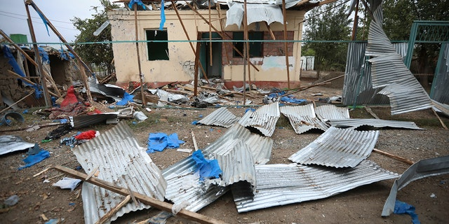A destroyed house damaged by shelling during fighting over the breakaway region of Nagorno-Karabakh in Terter, Azerbaijan, Saturday, Oct. 3, 2020. Armenia and Azerbaijan say heavy fighting is continuing in their conflict over the separatist territory of Nagorno-Karabakh and Azerbaijan's president said late Saturday his troops had taken a village. (AP Photo/Aziz Karimov)