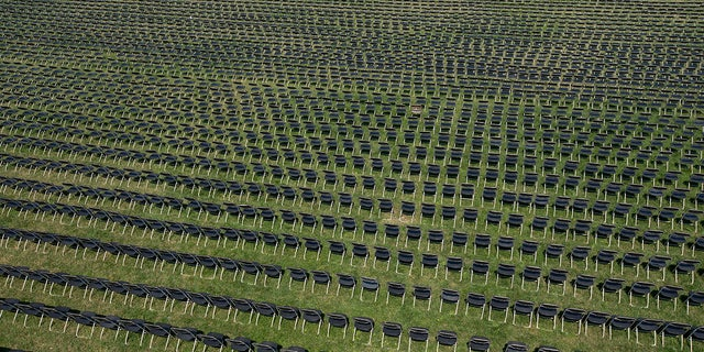 The empty chairs represent a fraction of the more than 200,000 lives lost due the COVID-19 are seen during the National COVID-19 Remembrance, at The Ellipse outside of the White House, Sunday, Oct. 4, 2020, in Washington. (AP Photo/Jose Luis Magana)