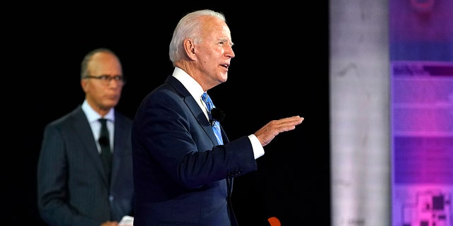 Democratic presidential candidate former Vice President Joe Biden speaks at a NBC Town Hall at Pérez Art Museum, Monday, Oct. 5, 2020, in Miami, as moderator Lester Holt listens. (AP Photo/Andrew Harnik)
