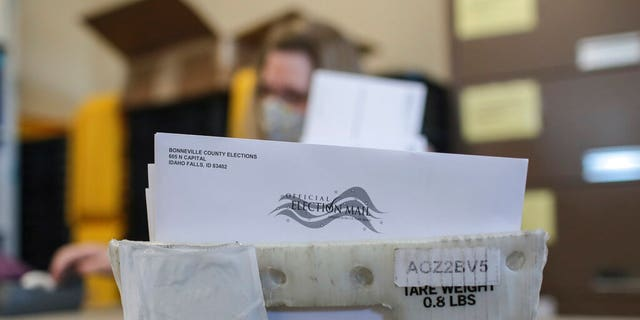 Mail-in election ballots are prepared at the Bonneville County Elections Office in Idaho Falls, Idaho on Tuesday, Oct. 6, 2020.
