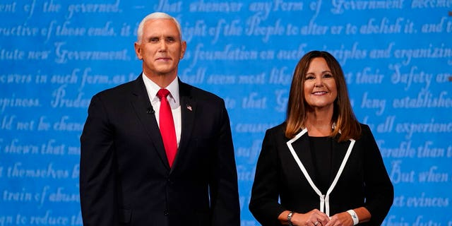 Vice President Mike Pence stands with his wife Karen Pence following the vice presidential debate with Democratic vice presidential candidate Sen. Kamala Harris, D-Calif., Wednesday, Oct. 7, 2020, at Kingsbury Hall on the campus of the University of Utah in Salt Lake City. (AP Photo/Patrick Semansky)