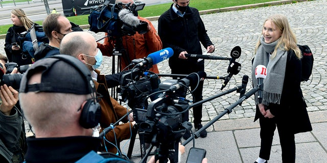 "Aava Murto, is interviewed by members of the media, in Helsinki, Finland, Wednesday, Oct. 7, 2020. A 16-year-old girl has assumed the post of Finnish prime minister for one day in the ""Girls Takeover"" scheme part of the U.Ns' Day of the Girl to raise more awareness of gender equality in the world. Aava Murto stepped into the shoes of Prime Minister Sanna Marin Wednesday to highlight the impact of technology on gender equality. (Heikki Saukkomaa/Lehtikuva via AP)"