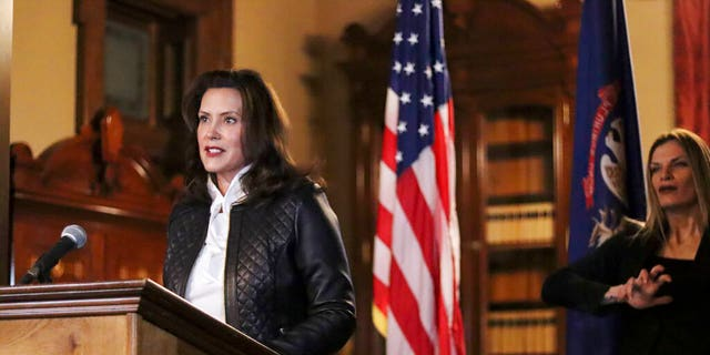 In a photo provided by the Michigan Office of the Governor, Michigan Gov. Gretchen Whitmer addresses the state during a speech in Lansing, Mich., Oct. 8. (Michigan Office of the Governor via AP)