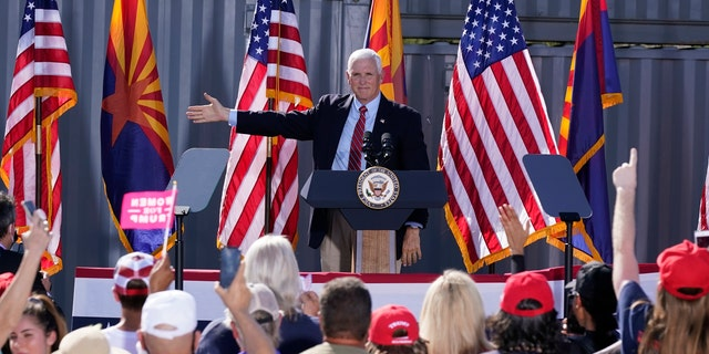 Vice President Mike Pence at a campaign rally at TYR Tactical Thursday, Oct. 8, 2020, in Peoria, Ariz. (AP Photo/Ross D. Franklin)