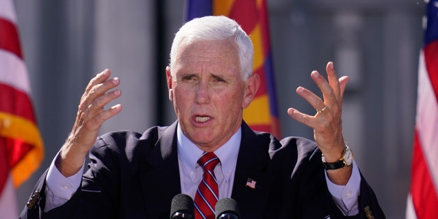 Vice President Mike Pence speaks at a campaign rally at TYR Tactical Thursday, Oct. 8, 2020, in Peoria, Ariz. (AP Photo/Ross D. Franklin)