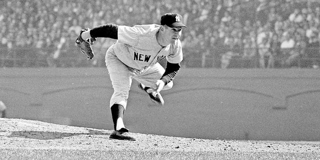 In this Oct. 12, 1960, file photo, New York Yankees pitcher Whitey Ford throws during the sixth game of the World Series against the Pittsburgh Pirates in Pittsburgh. A family member tells The Associated Press on Friday, Oct. 9, 2020, that Ford died at his Long Island home Thursday night. (AP Photo, File )