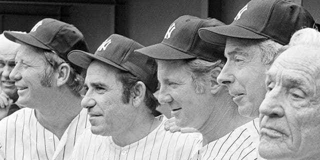 In this Aug. 3, 1974, file photo, New York Yankees, from left, Mickey Mantle, Yogi Berra, Whitey Ford, Joe DiMaggio and Casey Stengel gather on the steps of Shea Stadium in New York before an Old Timer's game. A family member tells The Associated Press on Friday, Oct. 9, 2020, that Ford died at his Long Island home Thursday night. (AP Photo/Ray Stubblebine, File)