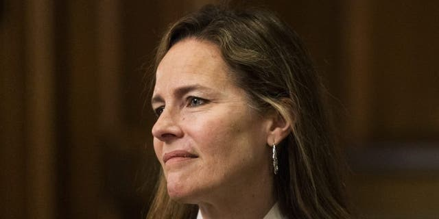 In this Oct. 1, 2020, file photo Supreme Court nominee Judge Amy Coney Barrett, listens as Sen. Steve Daines, R-Mont., speaks during their meeting on Capitol Hill in Washington. (AP Photo/Manuel Balce Ceneta, Pool, File)