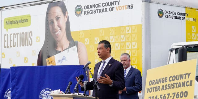 In this Oct. 5, 2020, file photo, California Secretary of State Alex Padilla, left, and Orange County Registrar of Voters Neal Kelley hold a news conference on Orange County's comprehensive plans to safeguard the election and provide transparency in Santa Ana, Calif. (AP Photo/Damian Dovarganes, File)