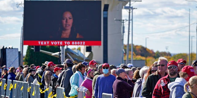 Supporters of President Donald Trump wait to enter a campaign rally Tuesday, Oct. 13, 2020, at John P. Murtha Johnstown-Cambria County Airport in Johnstown, Pa. (AP)
