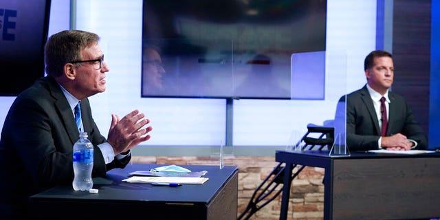 U.S. Sen. Mark Warner, D-Va., left, debates with Republican challenger Daniel Gade, right, at a television studio Oct. 13, in Richmond, Va. (AP Photo/Steve Helber)