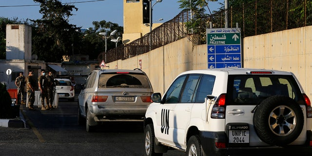 UNIFIL and civilian cars enter the headquarters of the U.N. peacekeeping force in the southern Lebanese border town of Naqoura, Lebanon, Wednesday, Oct. 14, 2020. (AP Photo/Bilal Hussein)