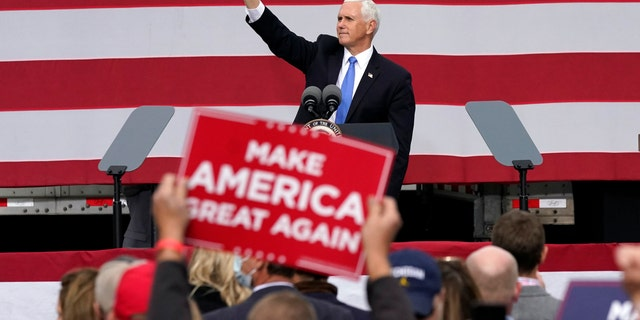 Vice President Mike Pence waves after speaking at a campaign rally, Wednesday, Oct. 14, 2020, in Grand Rapids, Mich. (Carlos Osorio)