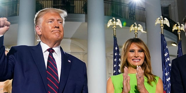 President Trump and First Lady Melania Trump stand on the South Lawn of the White House in Washington on August 27, 2020.  (Associated Press)